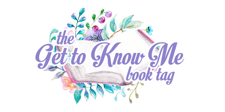 'Get to Know Me book tag'; text is light purple/lavender, outlined in white, overlaying an open book on top of floral/greenery; all is illustrated