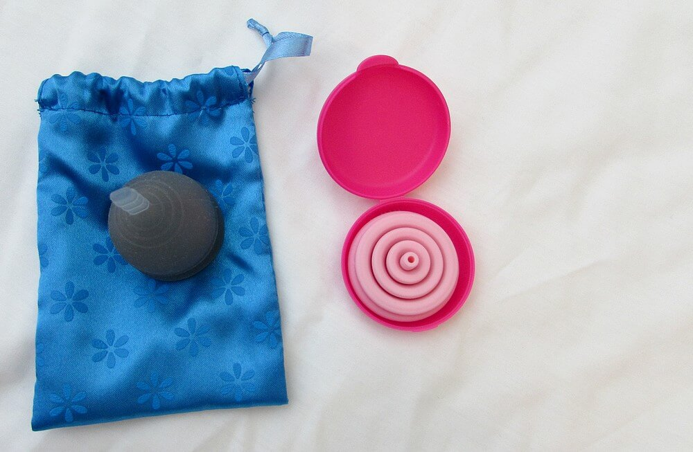 Photo of two (one blue, one pink) menstrual cups
