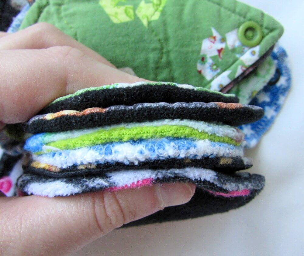 Photo of cloth pad pantyliners pressed together to show the thickness