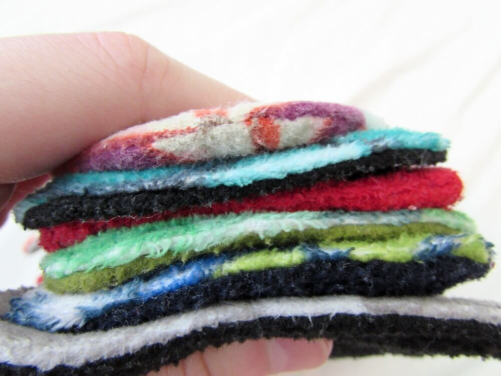 Photo of cloth day and night pads pressed together to show the thickness