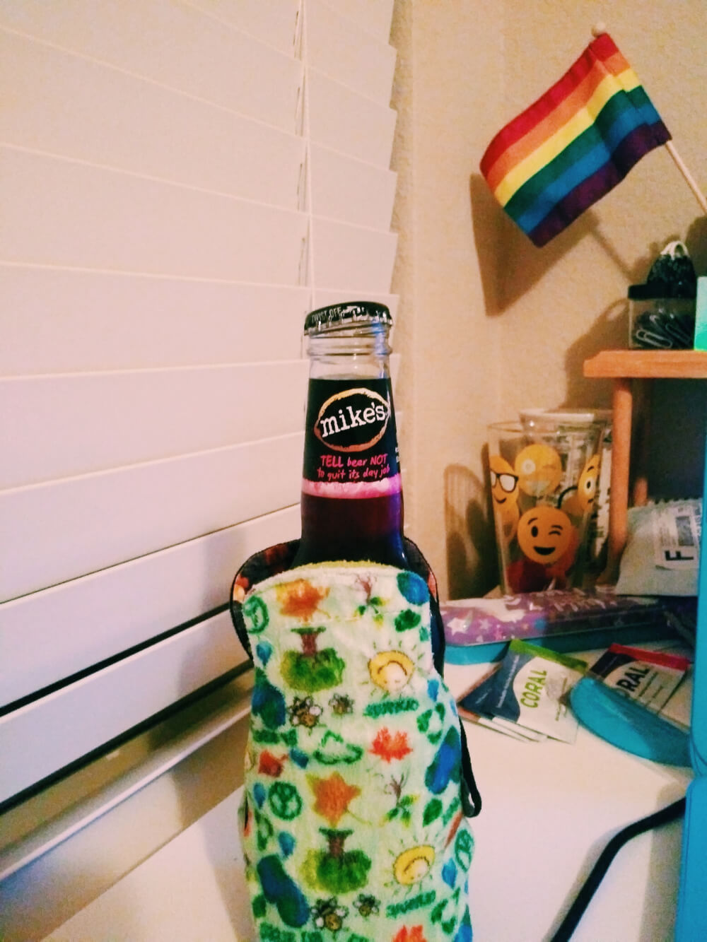 Two cloth pantyliners wrapped around a bottle of Mike's Hard Lemonade Black Cherry