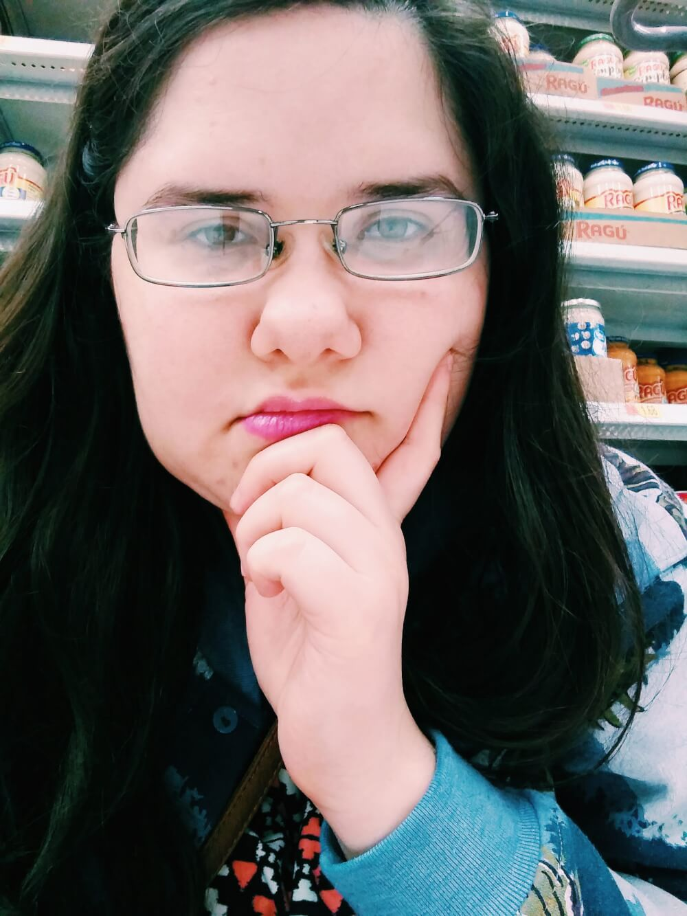 Nonchalant selfie while sitting in Walmart aisle on Black Friday