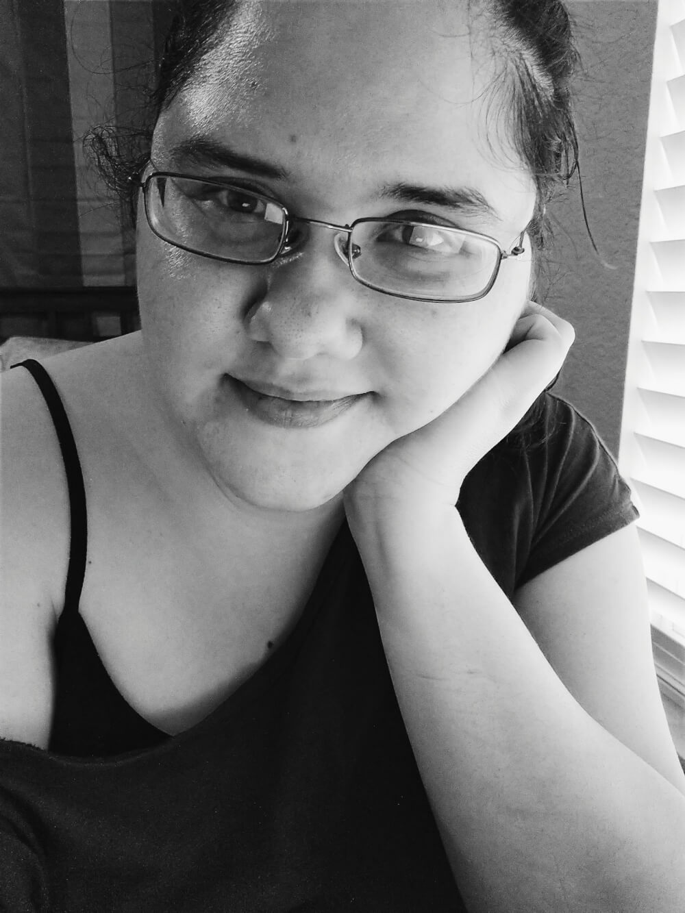 Black-and-white selfie in glasses and oversized top