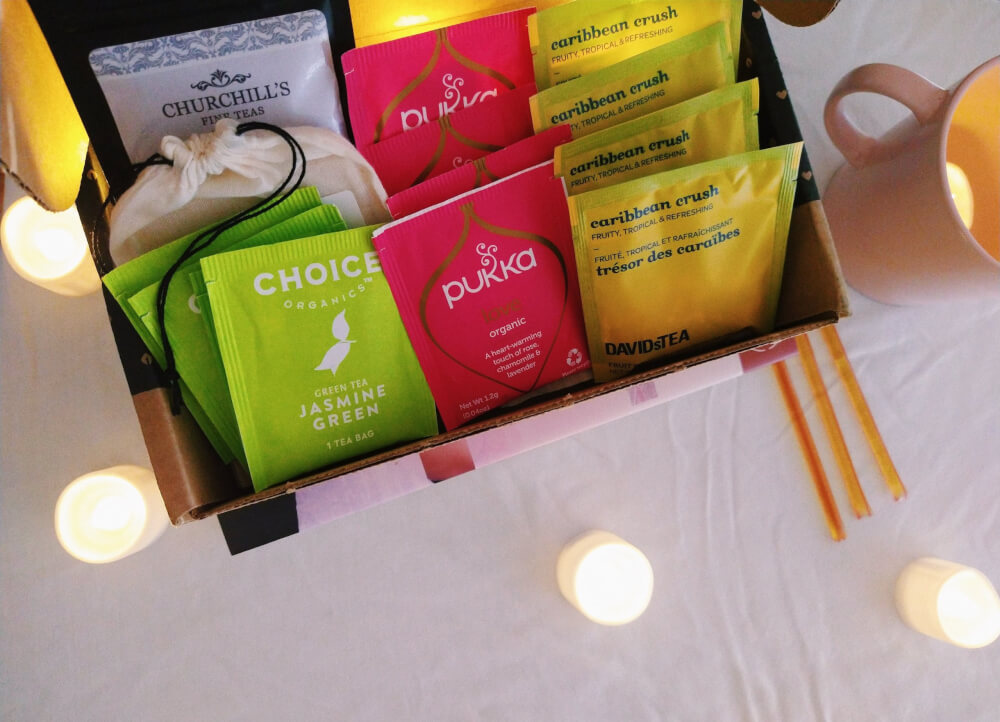 Sips by box displaying teas, close up overhead